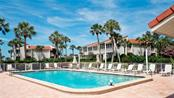 Heated, large community pool for Longbeach Condominium complex. - Condo for sale at 7145 Gulf Of Mexico Dr #24, Longboat Key, FL 34228 - MLS Number is A4433880