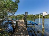 Dock with 2 boat lifts (20,000+ lbs & 4500 lbs), Forked Creek waterway - Single Family Home for sale at 1361 Bayshore Dr, Englewood, FL 34223 - MLS Number is A4433943