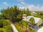 Single Family Home for sale at 9265 Blind Pass Rd, Sarasota, FL 34242 - MLS Number is A4436645