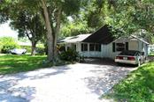 Carport to keep you dry (and your car clean). - Single Family Home for sale at 2220 Pine Ter, Sarasota, FL 34231 - MLS Number is A4440562