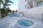 Outdoor amenities shared by only 8 residences. - Condo for sale at 609 Golden Gate Pt #202, Sarasota, FL 34236 - MLS Number is A4441802