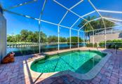 Peaceful view over the private pool to the pond and golf course. - Single Family Home for sale at 8727 53rd Ter E, Bradenton, FL 34211 - MLS Number is A4447005