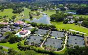 Community Tennis Courts - Single Family Home for sale at 586 N Macewen Dr, Osprey, FL 34229 - MLS Number is A4451482