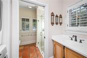Master bath with stackable washer and dryer - Single Family Home for sale at 3838 Flores Ave, Sarasota, FL 34239 - MLS Number is A4461669