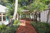Courtyard breezeway - Single Family Home for sale at 3838 Flores Ave, Sarasota, FL 34239 - MLS Number is A4461669