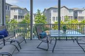 Main level screened deck. - Condo for sale at 515 Forest Way, Longboat Key, FL 34228 - MLS Number is A4465231