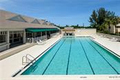Ready for laps or lounging. - Condo for sale at 515 Forest Way, Longboat Key, FL 34228 - MLS Number is A4465231