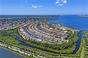 Aerial view of Harbour Walk at The Inlets and the Manatee River - Vacant Land for sale at 680 Regatta Way, Bradenton, FL 34208 - MLS Number is A4468555
