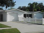 Front Elevation and Garage - Single Family Home for sale at 5326 Colewood Pl, Sarasota, FL 34232 - MLS Number is A4471495