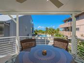 Spectacular beach views from covered porch - Single Family Home for sale at 500 Beach Rd #1, Sarasota, FL 34242 - MLS Number is A4474527