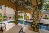Prepare to be enchanted while floating in the welcoming heated 45 foot lap pool with custom glass tiles. - Single Family Home for sale at 1807 Oleander St, Sarasota, FL 34239 - MLS Number is A4475067