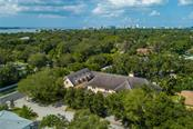 Only two blocks to the bay, this French chateau occupies 3 lots and almost 1/2 acre in Southside Village, near Cherokee Park and Harbor Acres. - Single Family Home for sale at 1807 Oleander St, Sarasota, FL 34239 - MLS Number is A4475067
