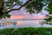 Dusk over Little Sarasota Bay - Single Family Home for sale at 8377 Midnight Pass Rd, Sarasota, FL 34242 - MLS Number is A4476899