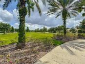 Long view of the Park in front of the Home - Single Family Home for sale at 16009 Clearlake Ave, Lakewood Ranch, FL 34202 - MLS Number is A4478013