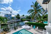 Second floor view of pool and canal. - Single Family Home for sale at 718 Key Royale Dr, Holmes Beach, FL 34217 - MLS Number is A4480381