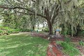 Mature oak trees and river views - Single Family Home for sale at 7118 68th Dr E, Bradenton, FL 34203 - MLS Number is A4480398