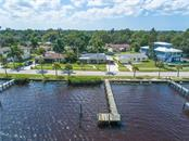 Aerial view of home and dock. - Single Family Home for sale at 2408 Riverside Dr E, Bradenton, FL 34208 - MLS Number is A4480609