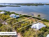 Estimated boundaries for Lot 11 and Lot 13 located in Fishermens Bay - Vacant Land for sale at 11 Fishermens Bay Dr, Sarasota, FL 34231 - MLS Number is A4493227