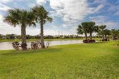 Waterfront end unit provides great waterfront views from your patio and almost every room! - Villa for sale at 13883 Botteri St, Venice, FL 34293 - MLS Number is A4493523