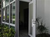 EXIT BACKDOOR TO LAGOON AREA - Condo for sale at 1087 W Peppertree Dr #221d, Sarasota, FL 34242 - MLS Number is A4493593