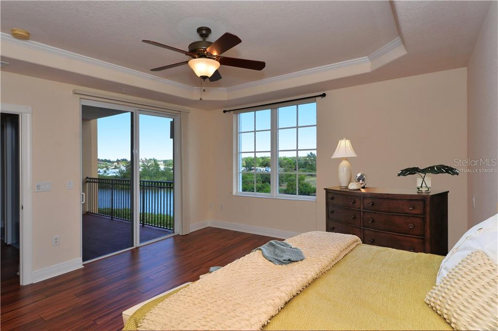 Master bedroom with sliding glass doors to balcony - Virtually Staged - Condo for sale at 167 Tampa Ave E #513, Venice, FL 34285 - MLS Number is N5911190