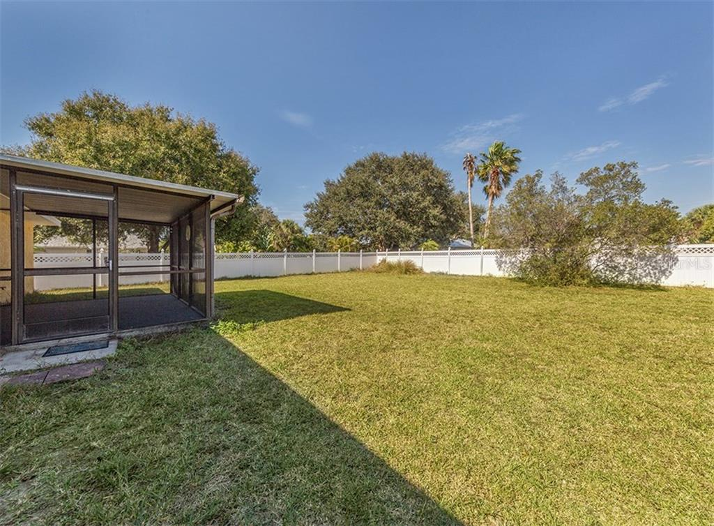 Yard - Single Family Home for sale at 10308 Grail Ave, Englewood, FL 34224 - MLS Number is N5911429