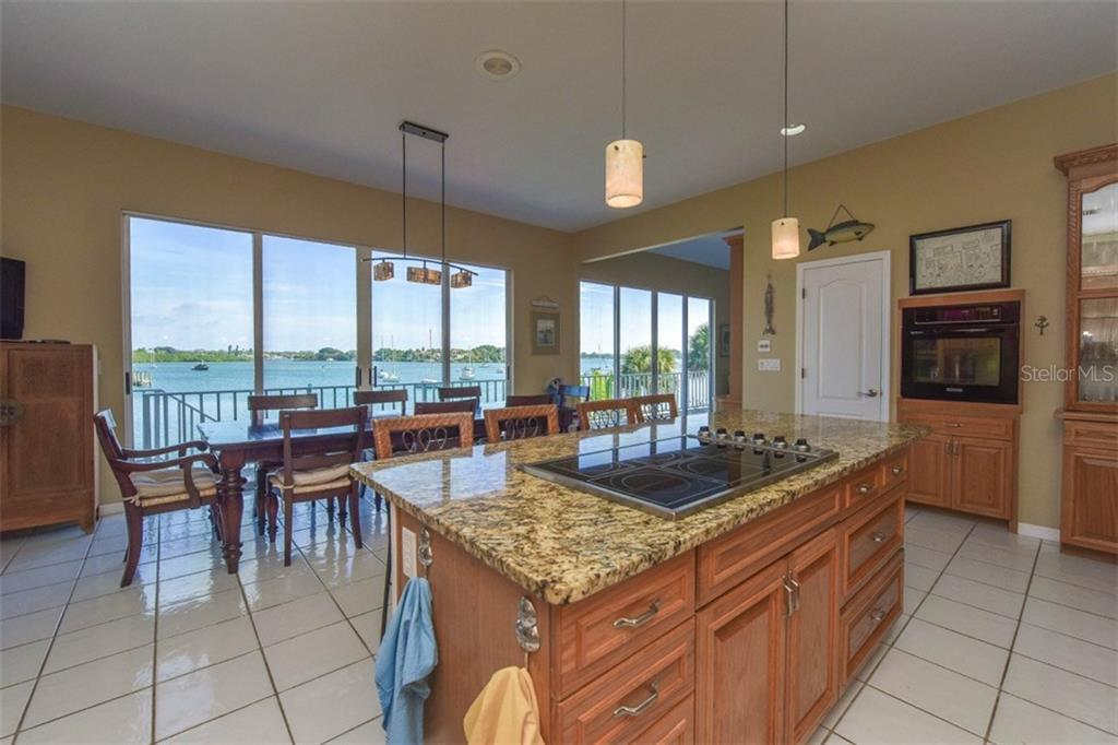 Kitchen to dining room - Single Family Home for sale at 725 El Dorado Dr, Venice, FL 34285 - MLS Number is N5911780