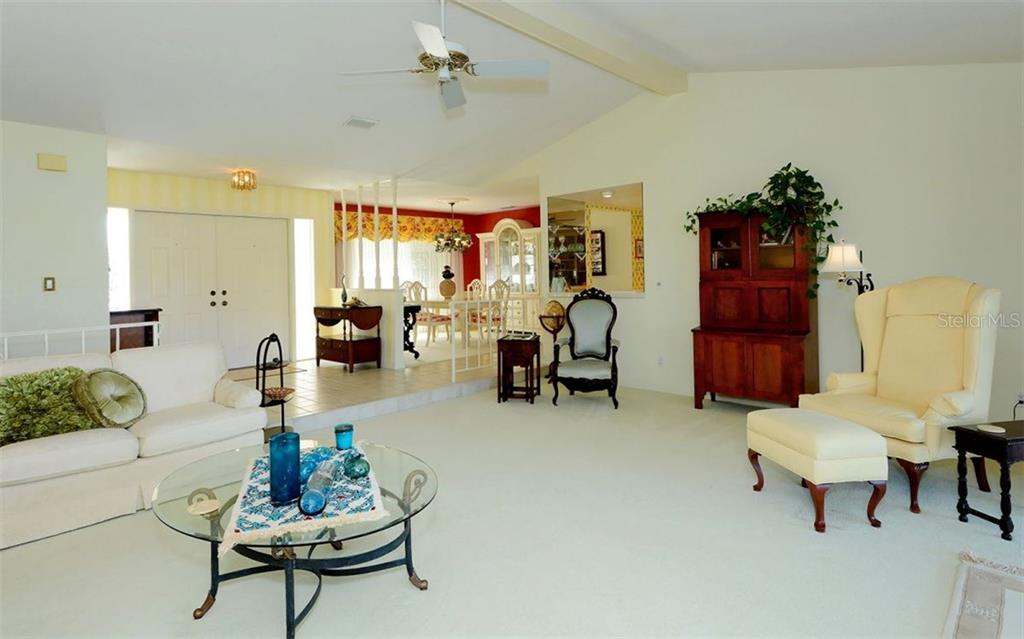 Entrance to Living Room / Dining Room - Single Family Home for sale at 1933 Innisbrook Ct, Venice, FL 34293 - MLS Number is N5912040