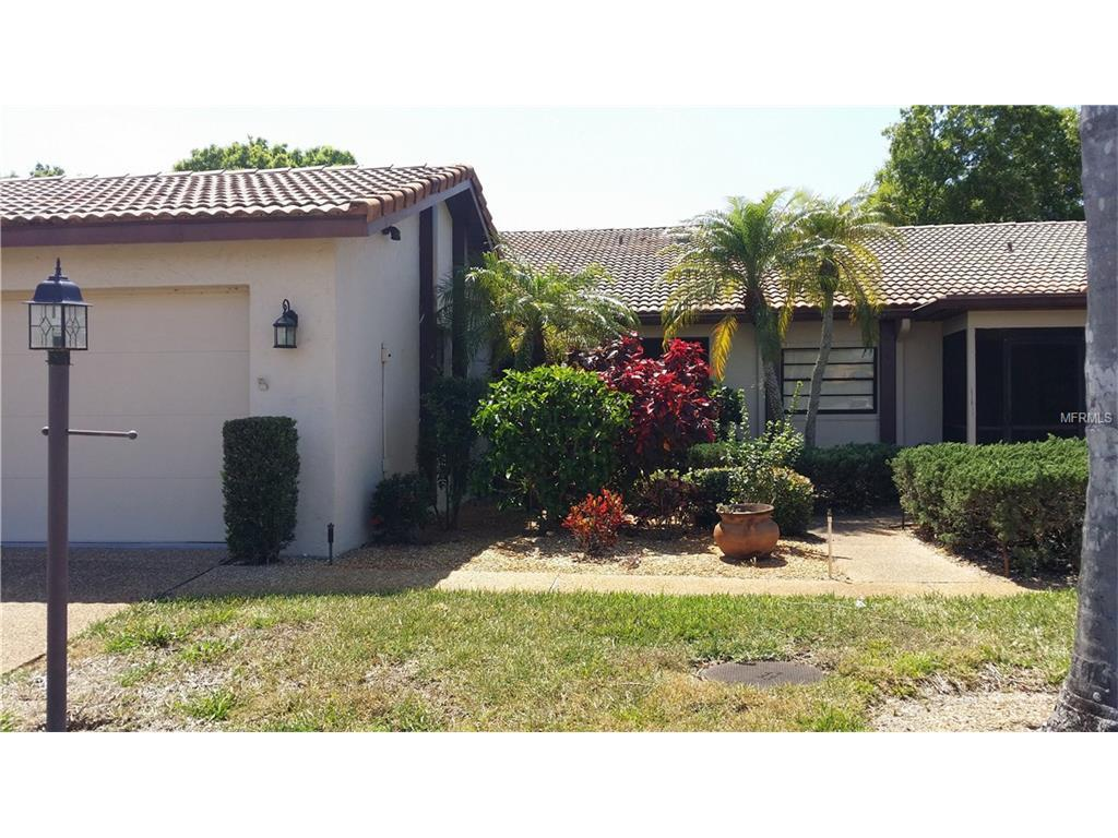 Entrance with a 2 car gar - Villa for sale at 855 Country Club Cir #38, Venice, FL 34293 - MLS Number is N5912404