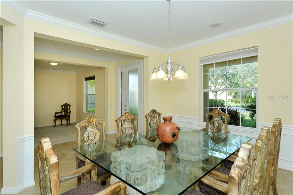 Dining room, foyer, den - Single Family Home for sale at 19168 Jalisca St, Venice, FL 34293 - MLS Number is N5912651