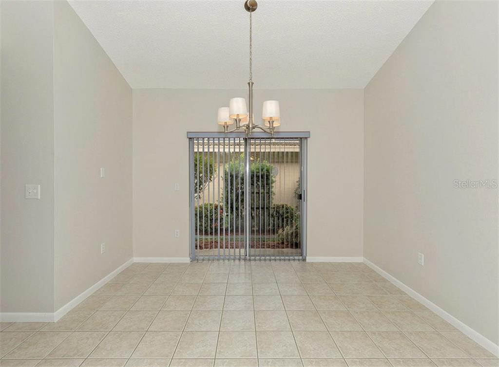 Dining Room - Single Family Home for sale at 3160 Willow Springs Cir, Venice, FL 34293 - MLS Number is N5912811