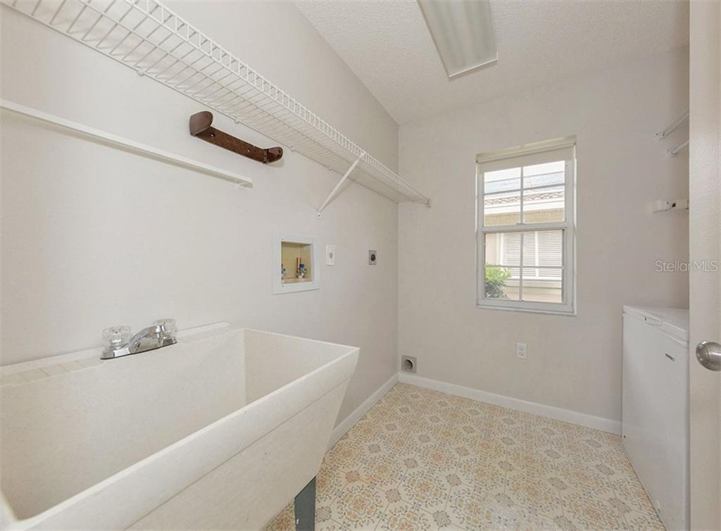 Laundry Room - Single Family Home for sale at 3160 Willow Springs Cir, Venice, FL 34293 - MLS Number is N5912811