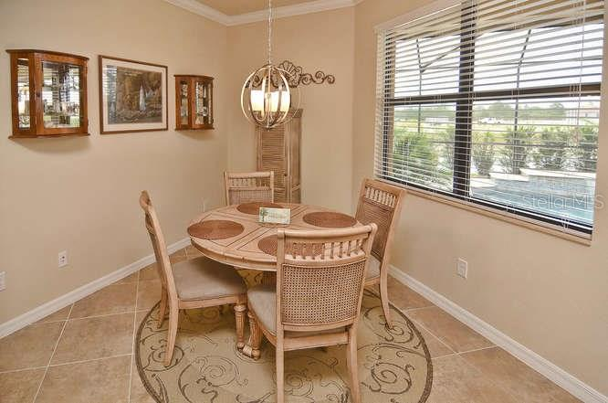 Dinette overlooking pool - Single Family Home for sale at 13210 Amerigo Ln, Venice, FL 34293 - MLS Number is N5913012