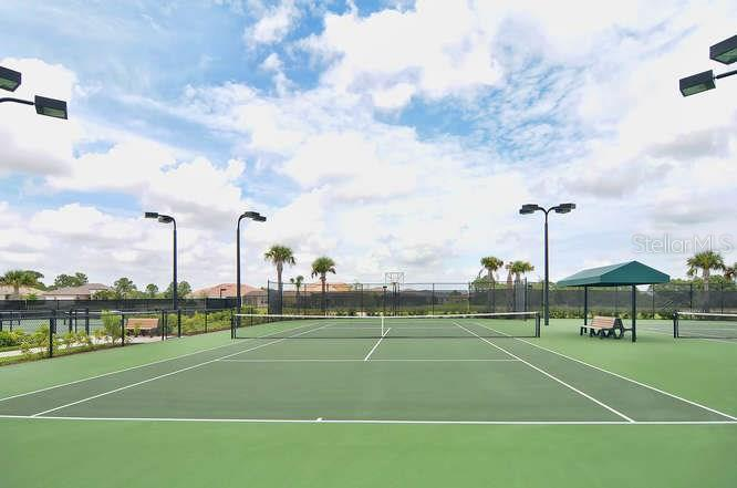 One of many tennis courts at clubhouse for your use. - Single Family Home for sale at 13210 Amerigo Ln, Venice, FL 34293 - MLS Number is N5913012