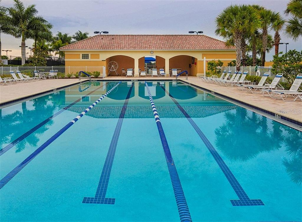 Community lap pool - Single Family Home for sale at 19131 Kirella St, Venice, FL 34293 - MLS Number is N5913074