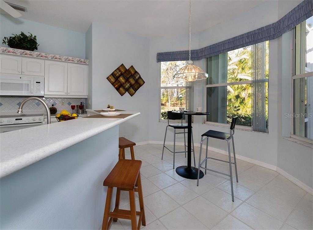 Kitchen to dining room - Single Family Home for sale at 2122 Timucua Trl, Nokomis, FL 34275 - MLS Number is N5913111