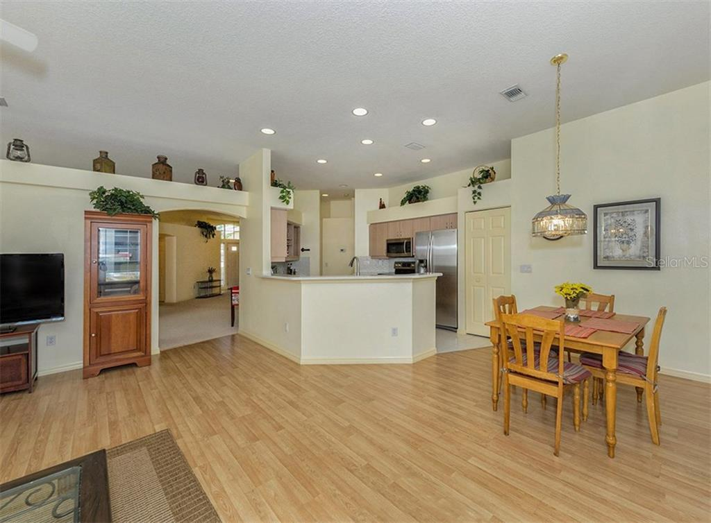 Family room to kitchen - Single Family Home for sale at 214 Vestavia Dr, Venice, FL 34292 - MLS Number is N5913794