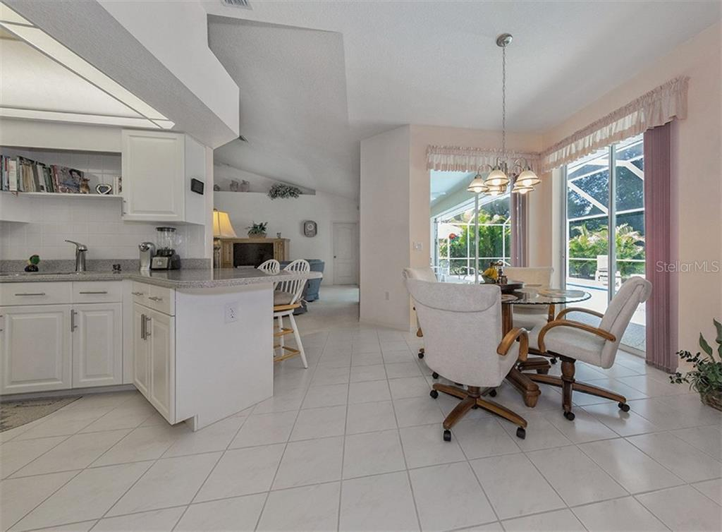 Dinette to kitchen and great room - Single Family Home for sale at 577 Park Estates Sq, Venice, FL 34293 - MLS Number is N5914129