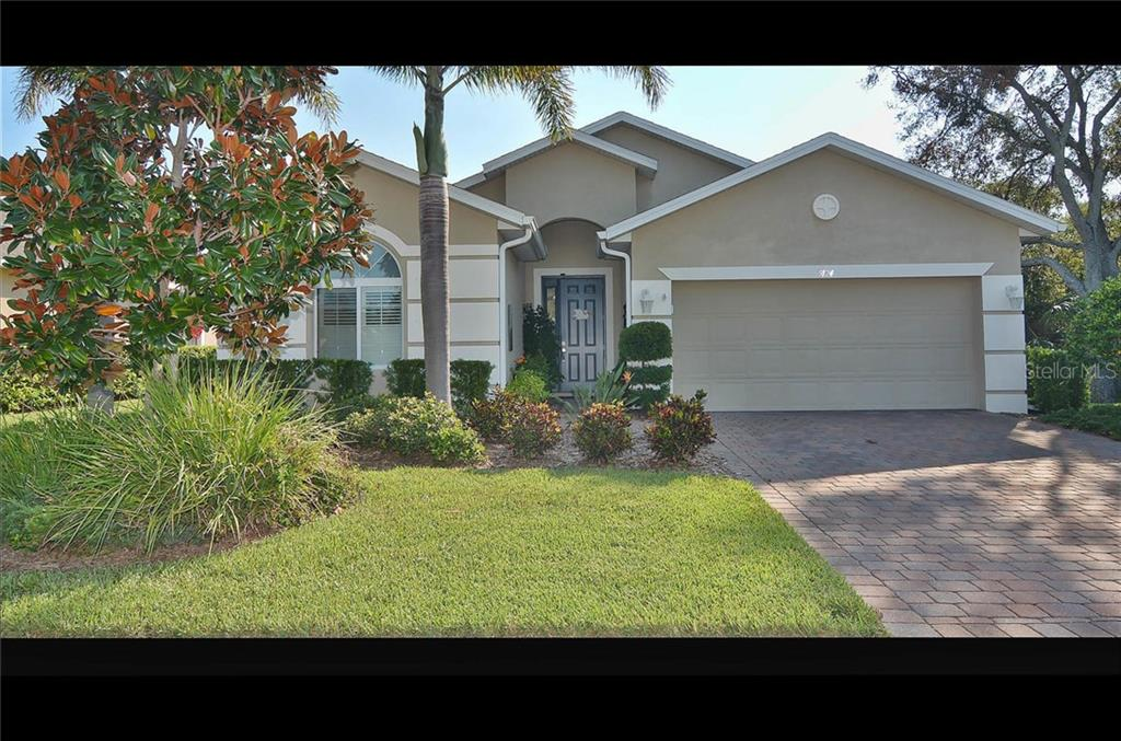 Front - Single Family Home for sale at 9124 Coachman Dr, Venice, FL 34293 - MLS Number is N5914408