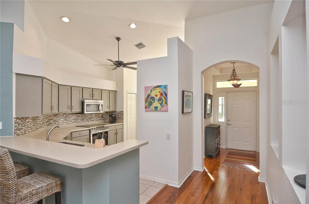 Foyer/kitchen - Single Family Home for sale at 498 Meadow Sweet Cir, Osprey, FL 34229 - MLS Number is N5914789