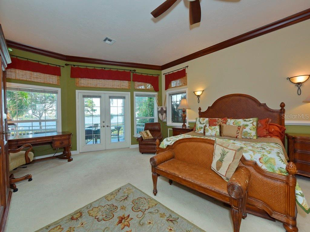 Master Bedroom boasting a view that is sure to astound you all day long! - Single Family Home for sale at 200 Sunrise Dr, Nokomis, FL 34275 - MLS Number is N5914820