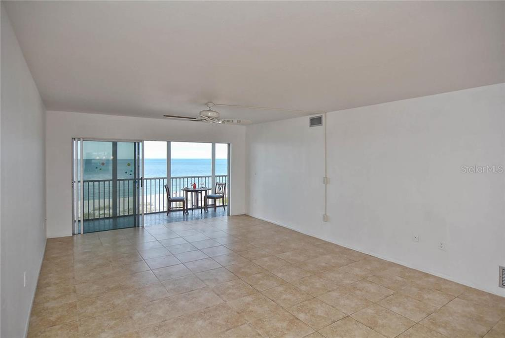 Living room with sliders to lanai, with view of the Gulf - Condo for sale at 333 The Esplanade N #402, Venice, FL 34285 - MLS Number is N5914981