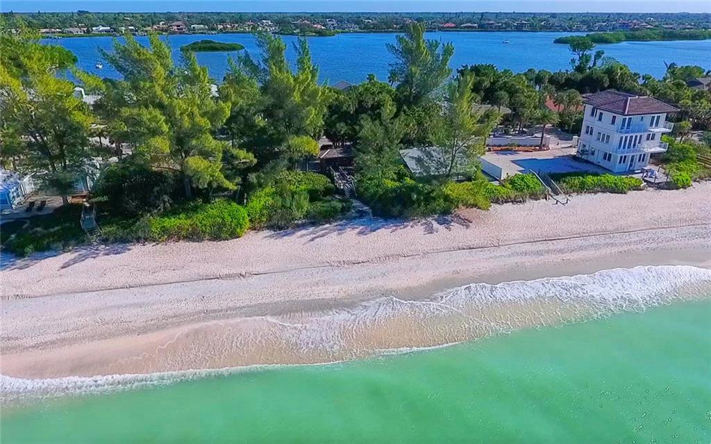 View of the home from the Gulf, looking towards the bay. - Single Family Home for sale at 3509 Casey Key Rd, Nokomis, FL 34275 - MLS Number is N5915098