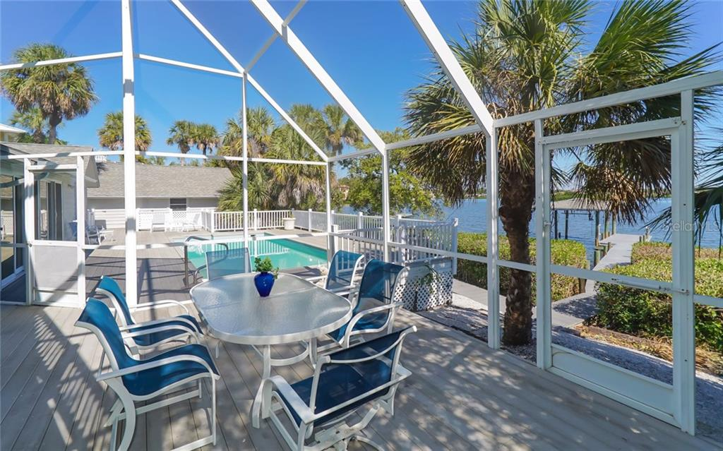 Covered lanai section of deck area enhances space for entertaining. - Single Family Home for sale at 3509 Casey Key Rd, Nokomis, FL 34275 - MLS Number is N5915098