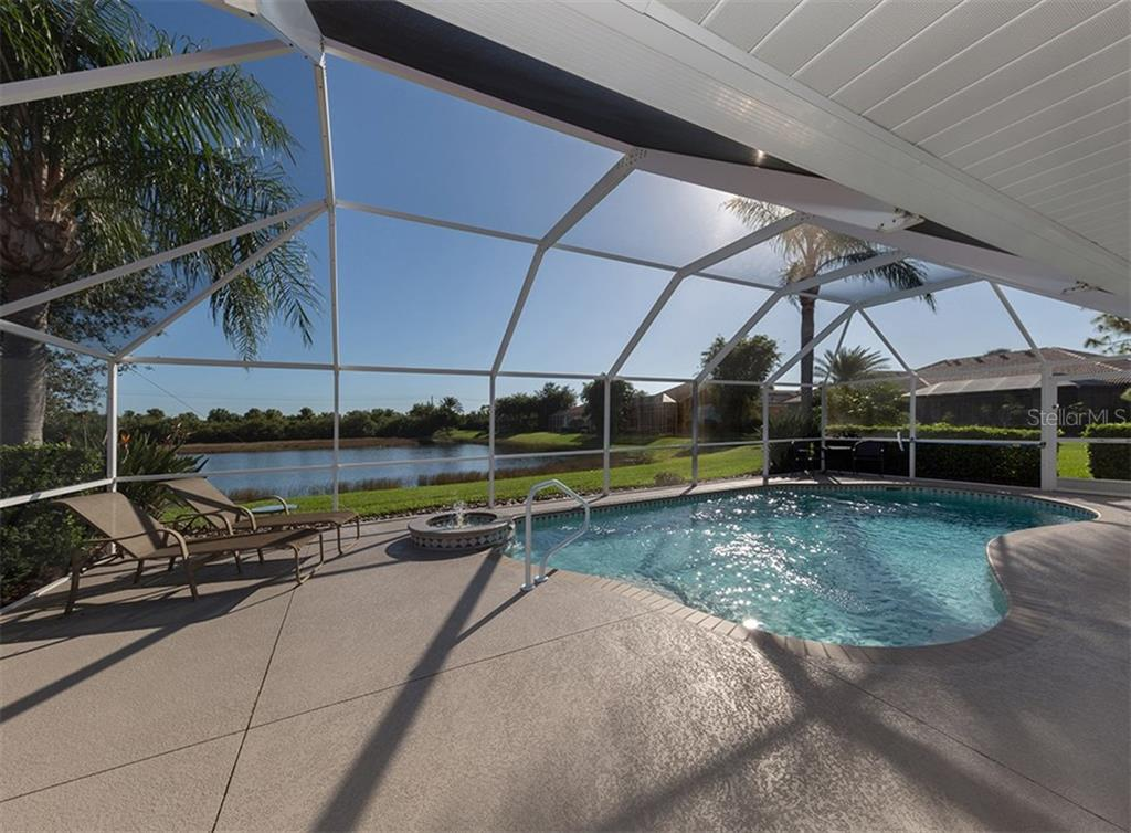 Pool with view of lake - Single Family Home for sale at 866 Wood Sorrel Ln, Venice, FL 34293 - MLS Number is N5915362
