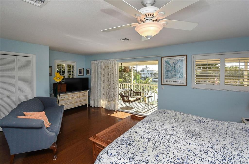 Master bedroom with sliders to lanai - Single Family Home for sale at 910 Casey Cove Dr, Nokomis, FL 34275 - MLS Number is N5915385