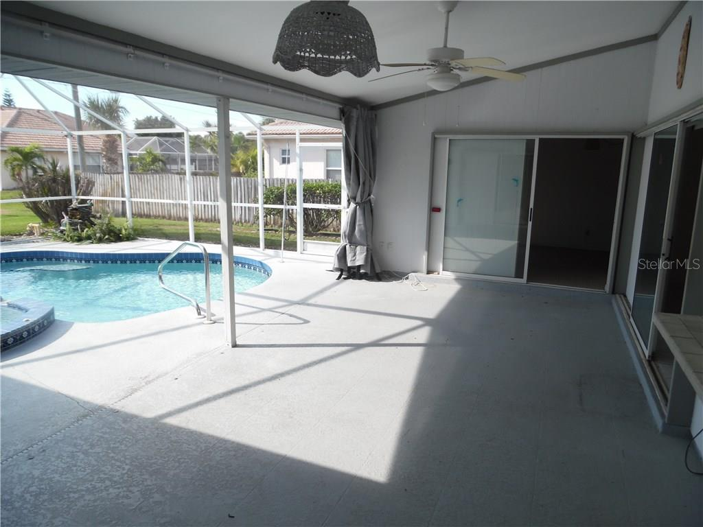 covered porch between the pool and breakfast area - Single Family Home for sale at 441 Baynard Dr, Venice, FL 34285 - MLS Number is N5915507