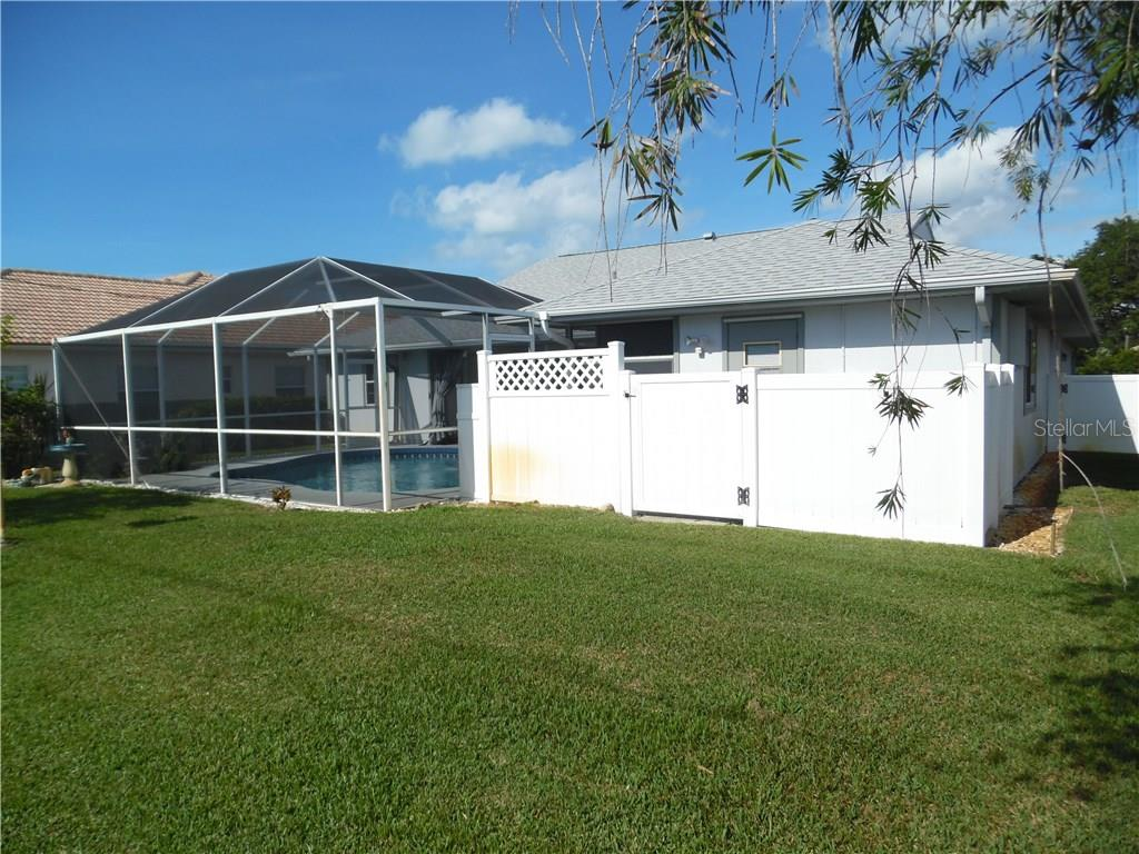 back of house, southeast corner - Single Family Home for sale at 441 Baynard Dr, Venice, FL 34285 - MLS Number is N5915507