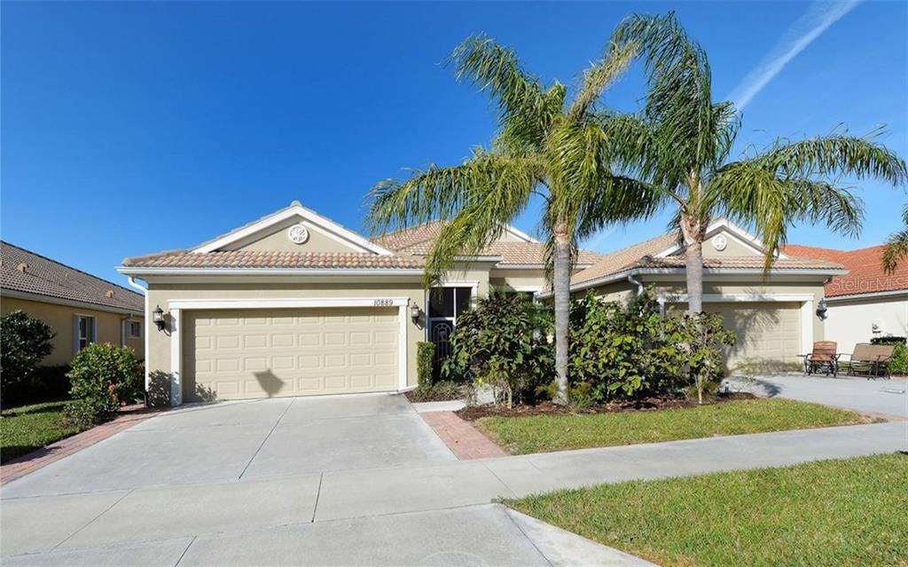 Front Exterior View - Villa for sale at 10889 Lerwick Cir, Englewood, FL 34223 - MLS Number is N5916198