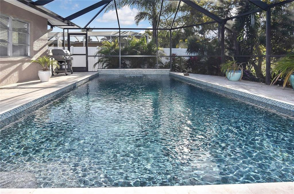 Long view of pool - Single Family Home for sale at 405 Sunset Dr, Venice, FL 34285 - MLS Number is N5917234